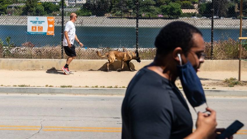 People run near Silver Lake Reservoir.