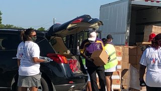 Hundreds turned out Saturday for a back-to-school community relief drive in Dallas offering school supplies, food, and personal-protective equipment kits.