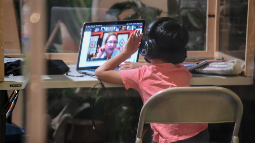 A student follows along remotely with their regular school teacher's online live lesson from a desk separated from others by plastic barriers at STAR Eco Station Tutoring & Enrichment Center on September 10, 2020, in Culver City, California.A student follows along remotely with their regular school teacher's online live lesson from a desk separated from others by plastic barriers at STAR Eco Station Tutoring & Enrichment Center on September 10, 2020, in Culver City, California.