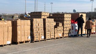 The National Guard and the Tarrant Area Food Bank teamed up Friday, to hand out hundreds of boxes of food to families in need.